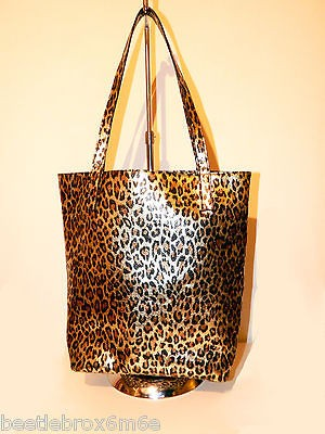 Lady Gagas Workshop Gold Leopard Skin Print Bag Tote from Barneys NY